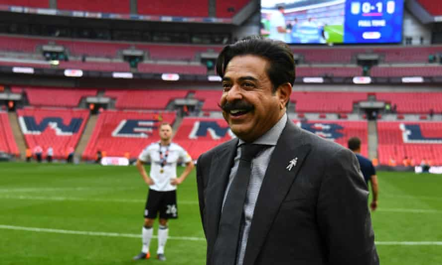 Shahid Khan on the Wembley pitch after their play-off final win this year. He has withdrawn an offer to buy the stadium.