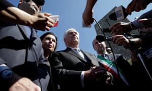 Rex Tillerson talks to reporters at a war memorial in Italy