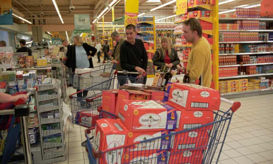 Shoppers with trolleys of alcohol in a Calais hypermarket