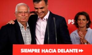 Spain's acting prime minister, Pedro Sánchez (centre), embraces the PSOE's lead candidate, Josep Borrell