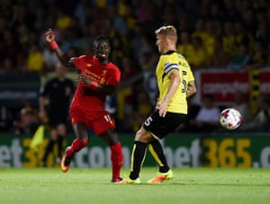 Sadio Mane gets the better of Burton's Kyle McFadzean.