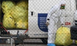 Medical waste is removed from the St Basil's Home for the Aged in the Melbourne suburb of Fawkner.