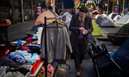 A homeless man examines donated clothing in Sydney's Martin Place.