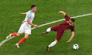 Gary Cahill is the wrong side of Artem Dzyuba and fouls him.