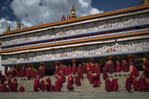 Tibetan Buddhist monks gather to pray at the Labrang Monastery in Xiahe, an ethnically-Tibetan town in Gansu province, China