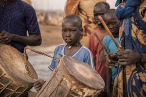 Boys hold drums during church prayers