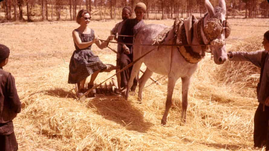 My mother with unnamed farmers, early 1960s.