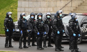 Riot police during an anti-lockdown protest in Melbourne, Victoria, on Saturday 12 September.