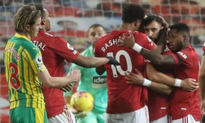 Manchester United's Bruno Fernandes celebrates scoring their first goal with team mates.