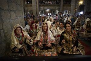 Women attend a mass in the church