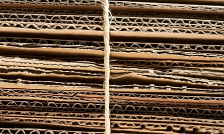 A bundle of corrugated cardboard tied with string