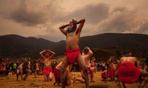 Yuin Djiringanj man Warren Foster Jr leads the burroo (kangaroo) dance at Gulaga mountain on 2 December, before the bushfires arrived.