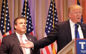 Chris Christie listens as Republican presidential candidate Donald Trump speaks to the media during a campaign event in Palm Beach, Florida.