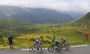 Romain Sicard (left), ahead of Luis Leon Sanchez and Lilian Calmejane on Col de Soulor, before making a break on his own.