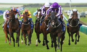 U S Navy Flag and his jockey Ryan Moore show the way to the finish line in this month's Dewhurst Stakes at Newmarket and could well be going for the Juvenile at Del Mar.