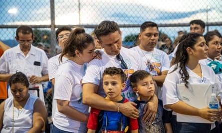 People take part in a prayer and vigil at Ponder Park in El Paso, Texas.