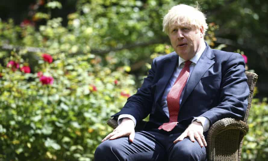Boris Johnson in the Downing Street rose garden in July