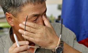 Shaariibuu Setev wipes away tears during a press conference in Kuala Lumpur in 2006