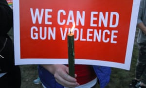 Mourners in Newtown, Connecticut, hold signs during a solidarity vigil in memory of victims of the Las Vegas shooting.