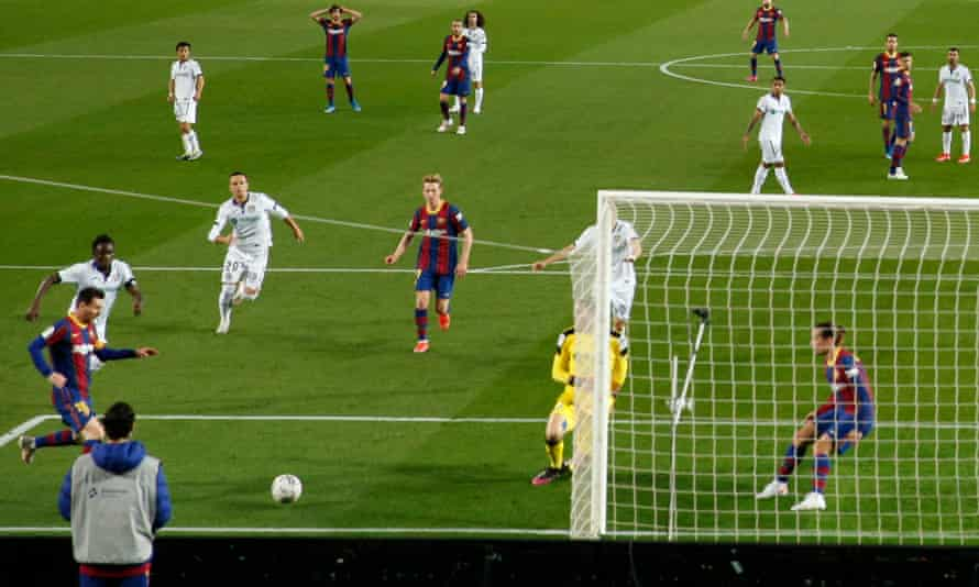 Lionel Messi (left) finishes from an acute angle to score Barcelona's third goal against Getafe.