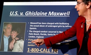 A photo of Ghislaine Maxwell and Jeffrey Epstein is seen as acting US attorney for the southern district of New York, Audrey Strauss, announced charges against Maxwell.