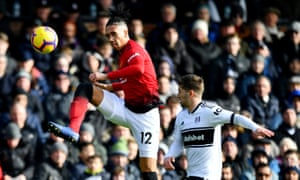 Chris Smalling beats Fulham's Luciano Vietto to the ball in Manchester United's 3-0 win at Craven Cottage.