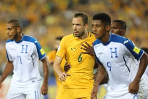 Matthew Jurman is held prior to a corner as the Socceroos look to extend their advantage.