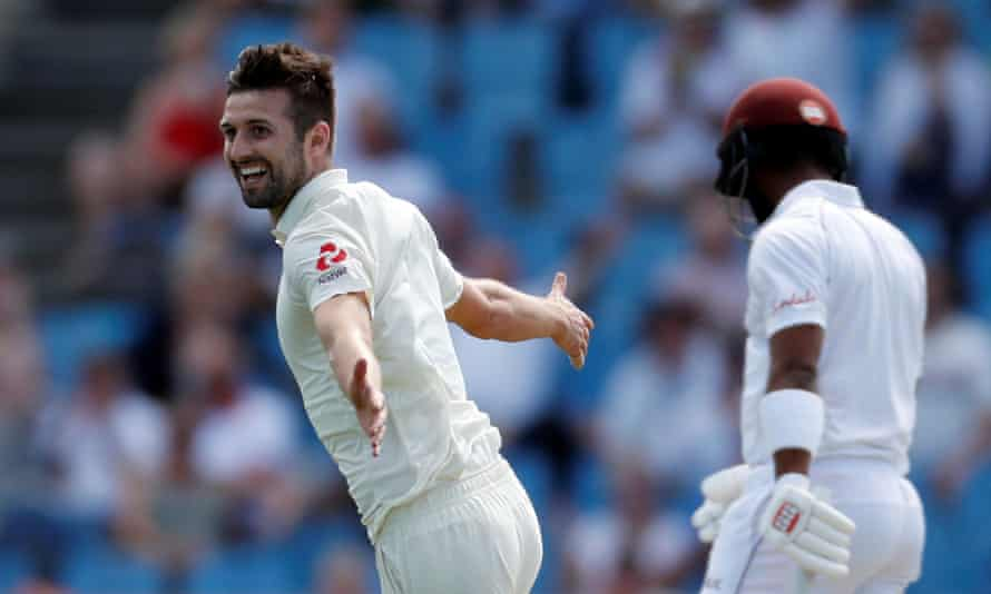 England's Mark Wood celebrates taking the wicket of West Indies' Roston Chase.