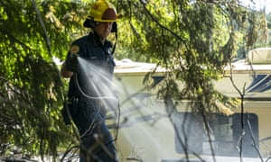 Firefighters from Bellingham, Washington, contain a brush fire that started from an unknown cause in a timber pile in the Chuckanut Mountain foothills, USA