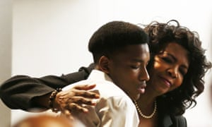 Dallas county district attorney Faith Johnson hugs Kevon Edwards, the older brother of Jordan Edwards, during the trial.