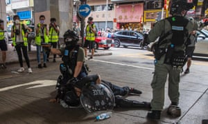 Riot police detain a man during protests in Hong Kong.