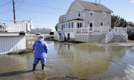 A resident viewed flooding near her home Sunday in Duxbury, Massachusets. The Northeast is bracing for its third nor'easter in fewer than two weeks.