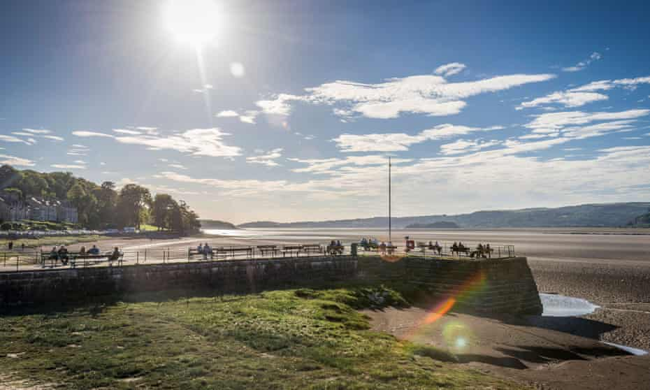 The village of Arnside with its pier on the River Kent estuary in Cumbria