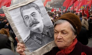 Supporter of the Ukrainian Communist Party holds a portrait of Joseph Stalin during a rally in 2005