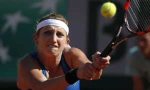Bacsinszky fires off a forehand return.