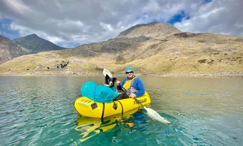 Jason Taylor packrafting with Crib Goch and Snowdon in the background.