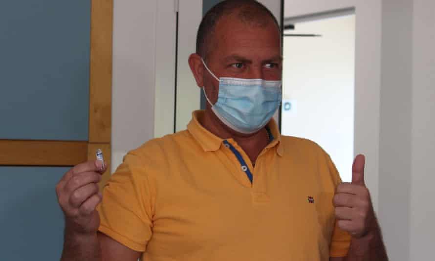 Latvian vaccine tourist Armens in San Marino with his souvenir Sputnik V vial.