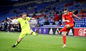 Wales' Gareth Bale crosses the ball to assist their side's first goal of the game scored by Daniel James.
