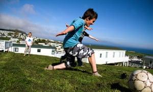 Children on holiday at a caravan park in Devon, UK