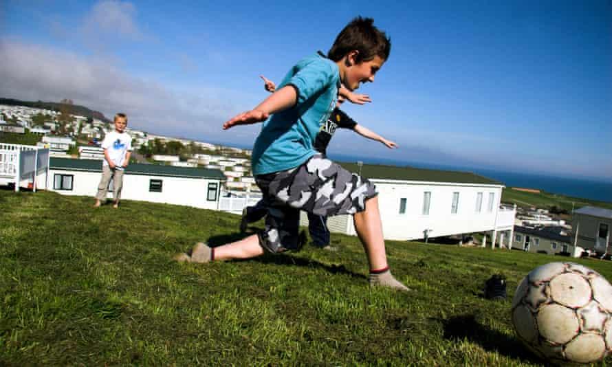 Children on holiday at a caravan park in Devon, UK.C4X2BX Children on holiday at a caravan park in Devon, UK.