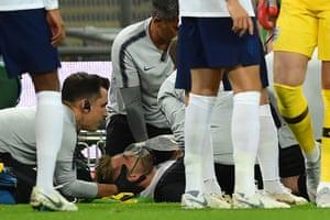 England's defender Luke Shaw receives medical attention after a clash with Spain's defender Dani Carvajal.