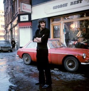 George Best outside the George Best Boutique in  Manchester.
