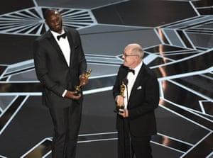 Retired NBA star Kobe Bryant and Glen Keane accept the award for best animated short for Dear Basketball.