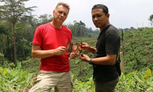 Chris Packham and charity fieldworker Kristiawan John with the 20-year-old photograph of Bunga.