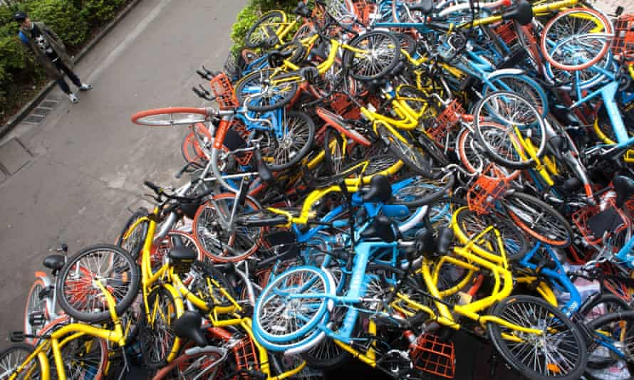 Share bikes dumped in huge piles near the entrance of Xiashan park in Shenzhen.