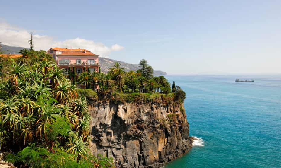 Reid's Palace Hotel, near a cliff-edge, overlooking blue sea in Madeira
