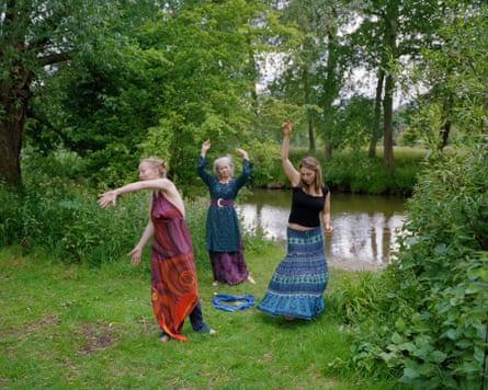 Oxford, 6:30pm: Members of the Oxford Pagan Circle performa river ritual. They dance around a goblet of red wine, a postcard of the Hokusai wave, some blue fabric and some incense sticks.