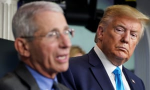 Donald Trump listens as Dr Anthony Fauci speaks during a coronavirus taskforce briefing at the White House on 7 April.