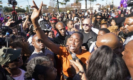 LaPorsha Washington, center, the mother of Jazmine Barnes, speaks during a rally outside Walmart on 5 January in Houston, Texas.