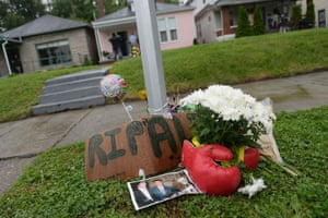 A makeshift memorial is seen outside the childhood home Ali